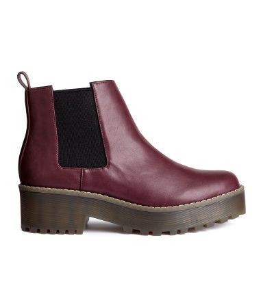 Chelsea boots in imitation leather with a platform, elastic panels at sides, and chunky rubber soles. Front platform height 1 1/4 in., heel height 2 in.
