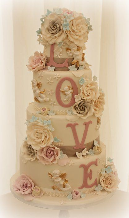 Neutral toned LOVE cake  One layer, lose the cherubs, and it's perfect for a smash.  Love the idea of an initial for the baby.