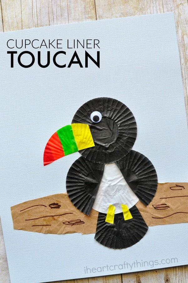 This cupcake liner toucan craft is simple to make and the brightly colored beak gives the craft such a fun pop of color. Fun bird craft for kids, cupcake liner crafts, crafts for kids and kids craft.