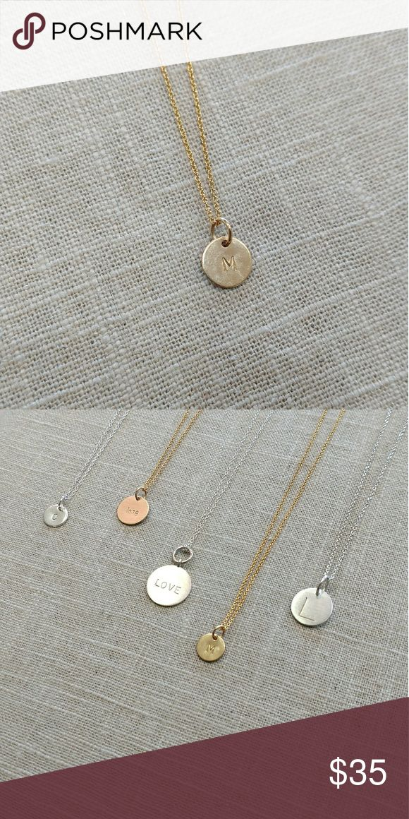 """Gold-filled """"M"""" initial pendant Gold-filled """"M"""" initial disc pendant with 16"""" chain. Disc is approximately 9.4mm in diameter. By Lotus Jewelry Studio. Lotus Jewelry Necklaces"""