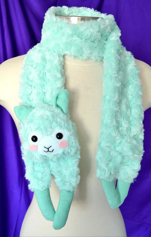 This mint colored Alpaca scarf is sure to grab attention! He is the perfect accessory to your Lolita or Fairy Kei outfit! He is soft and fuzzy to keep you warm~  He is made from swirly fur minky, and his mouth is carefully stitched on by hand.  His ears, and hooves are made from flanel, while h...