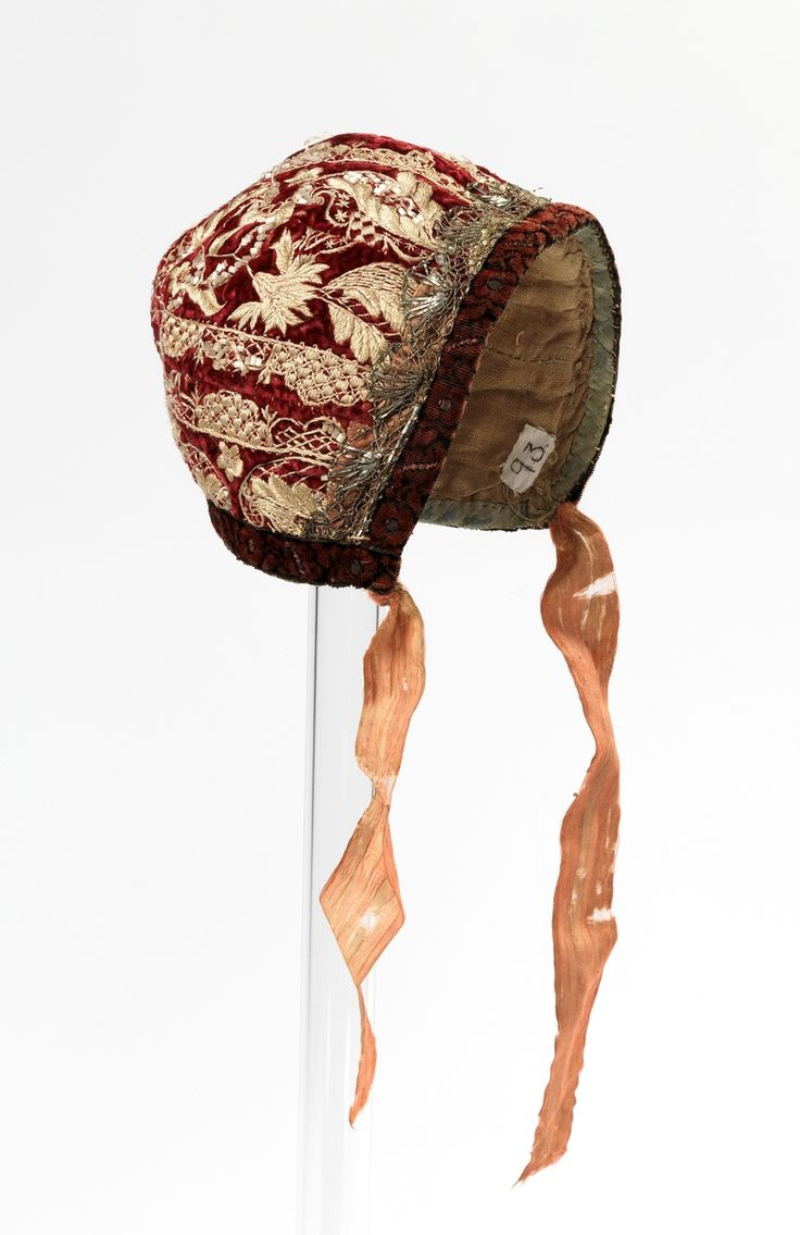 Infant's bonnet, Norway, first half 18th century. Dark red uncut silk velvet with floral gold thread embroidery, orange silk ribbon, linen lining.