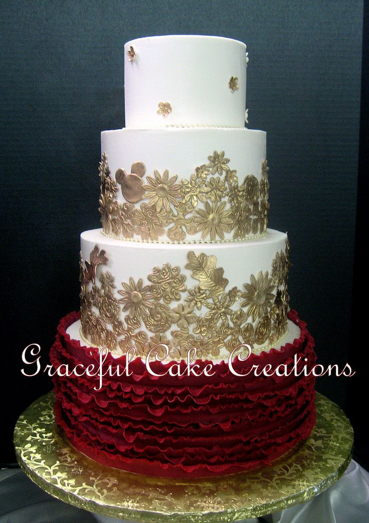 https://flic.kr/p/P6TgCB | Elegant Ivory Butter Cream Wedding Cake with Gold Floral Applique and Crimson Red Ruffles