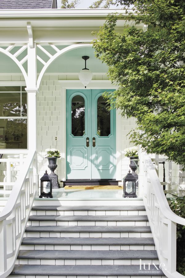 Turquoise blue front doors, vintage frosted glass pendant light, grey stone steps, white balustrade