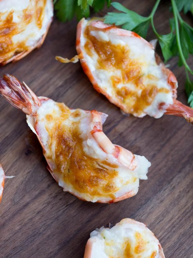 Cheesy Baked Tiger Shrimp Recipe was first introduced to me by a friend, years ago. She served us a fancy dinner with these shrimp. I've made these many times since, but wasn't sharing the recipe, since it's too simple. I am not a huge fan of shrimps in general, but I don't mind splurging on these tiger shrimp, because they remind me of mini lobsters. Really meaty and just perfect to be served as appetizers. Tiger shrimp are more expensive than your normal shrimp, but you will love them…