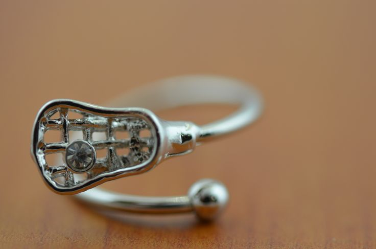 This cool silver lacrosse stick ring is the perfect lacrosse gift for any lax girl!