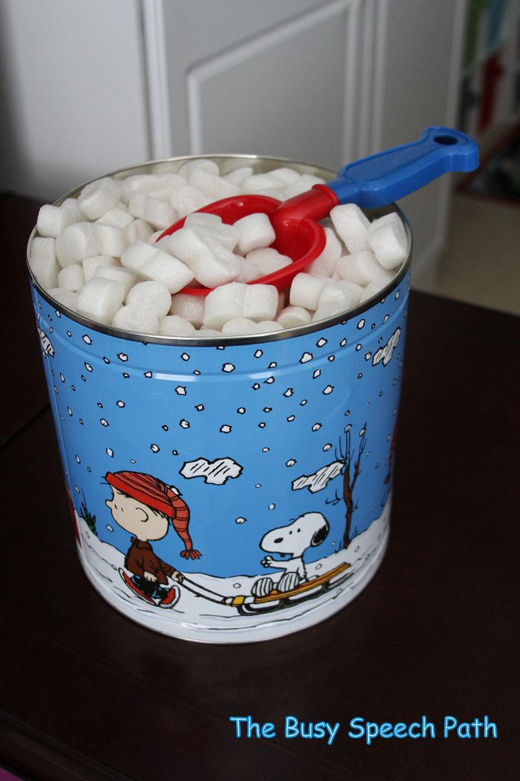 Snow Can- Have your students pretend to shovel snow while searching for pictures and objects! Materials needed- packing peanuts, a recycled popcorn tin can, and a toy shovel! Have fun! I've been using my snow can for many years!- Emily from The Busy Speech Path