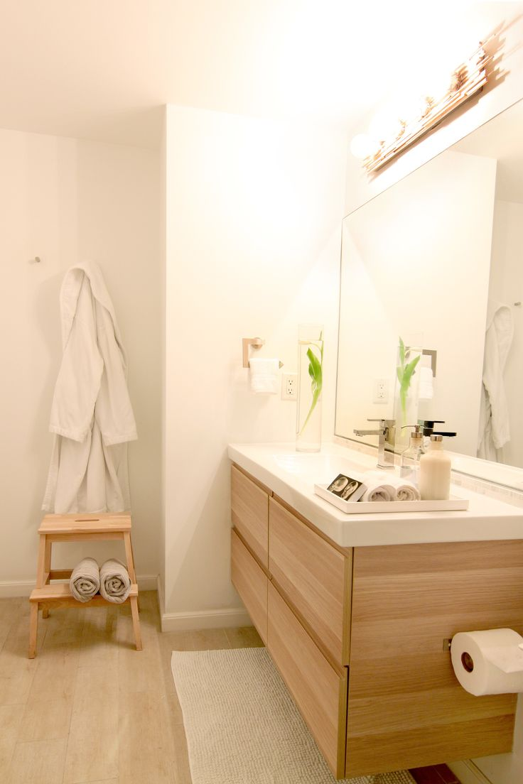 Web Image Gallery Ikea GODMORGON vanity in white stained oak effect Notice the DIY custom sconce Just get creative with balsa wood sticks and hot glue Be careful