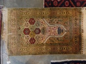 Africa then & now - Provenance Auction House: A Fine Silk and Hereke Prayer Rug. 1150 x 720mm.
