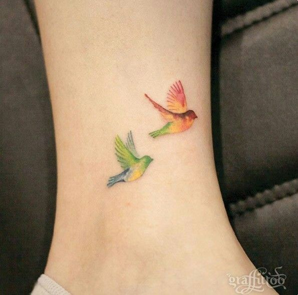 Colorful birds small ankle tattoo.