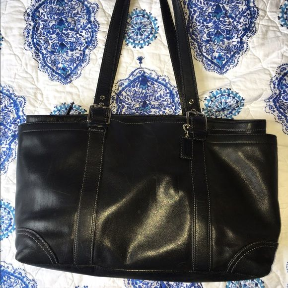 Black Coach purse, small frays, lining stained This black Coach purse has a zipper to close the entire purse, as well as a zipper inside for a safe pocket. The handles fray periodically but can be trimmed. Small unnoticeable scratches on leather. Inside lining partially stained. Coach Bags