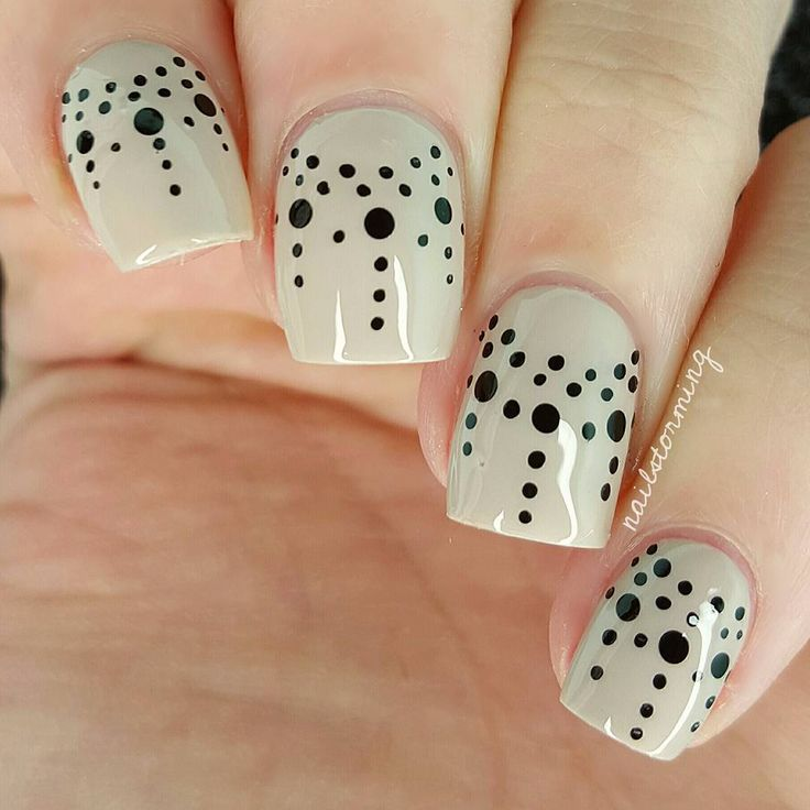 "Dots #dotticure nail art using ... Base: ""Sand Tropez"" by Essie, Black: acrylic paint, Tools: bobby pin & toothpick, Top coat: HK girl @glistenandglow1"