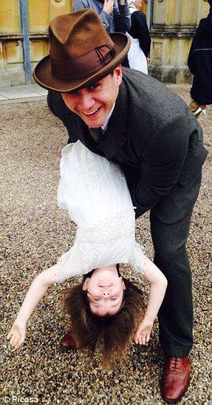 Branson (Allen Leech) tips over his daughter Lady Sibby (Fifi Hart) as they play on set at Highclere