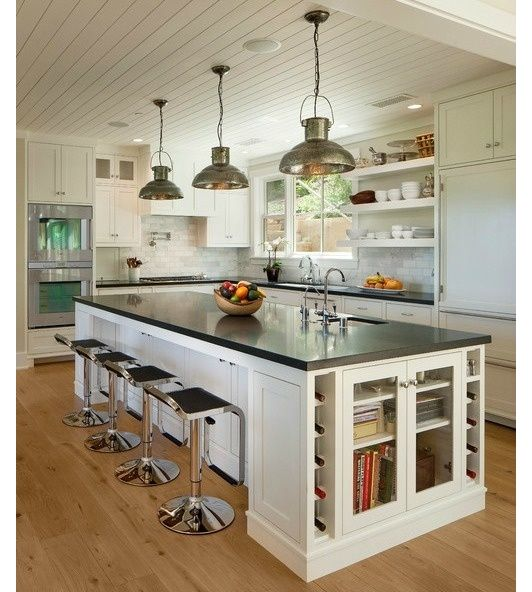 kitchen idea! it feels a bit too sterile/modern/sharp-edged for my taste, but I love the layout and the huge island with seating.