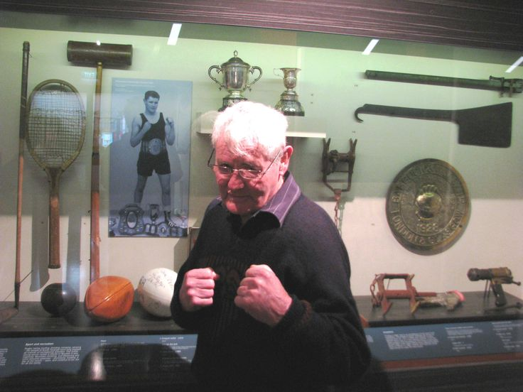 In 1961 ex-Patea man Denis McKenna won the New Zealand Featherweight Boxing Championship; his photograph is part of our exhibition on South Taranaki's sporting heritage. Last week Denis visited Aotea Utanganui Museum of South Taranaki and we took a quick photo of the champ with his photograph.