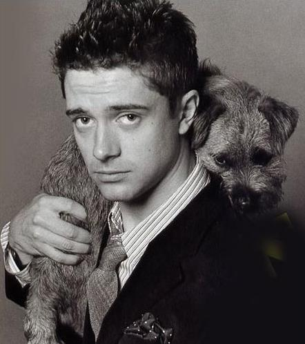Cute Border Terrier, oh and Topher Grace!