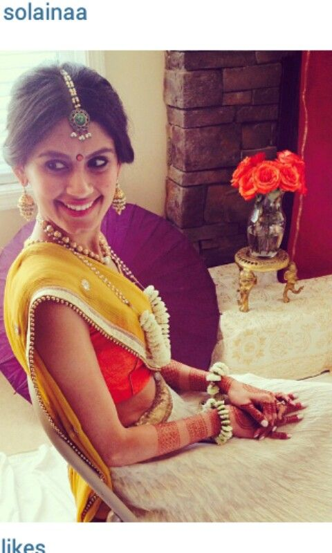Traditional Indian bride wearing bridal lehenga for the mehndi henna ceremony