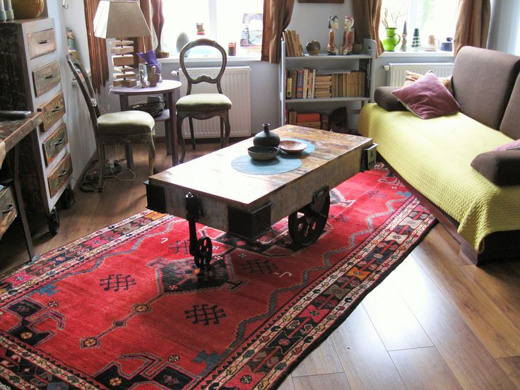 Wooden floor & furniture with a nice Lori - Bakhtiari handmade  Persian carpet.