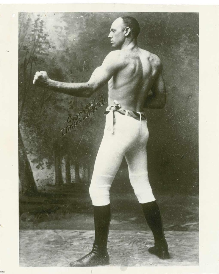 """Robert James """"Bob"""" Fitzsimmons (May 26, 1863 – October 22, 1917), was a British boxer who made boxing history as the sport's first three-division world champion. He also achieved fame for beating Gentleman Jim Corbett, the man who beat John L. Sullivan, and is in The Guinness Book of World Records as the Lightest heavyweight champion. Nicknamed Ruby Robert or The Freckled Wonder, he took pride in his lack of scars, and appeared in the ring wearing heavy woollen underwear to conceal the…"""