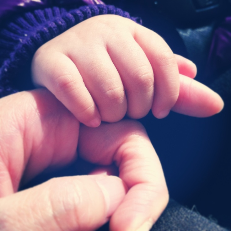 Sweet baby Audrey holding my finger with her baby hand~ cute!