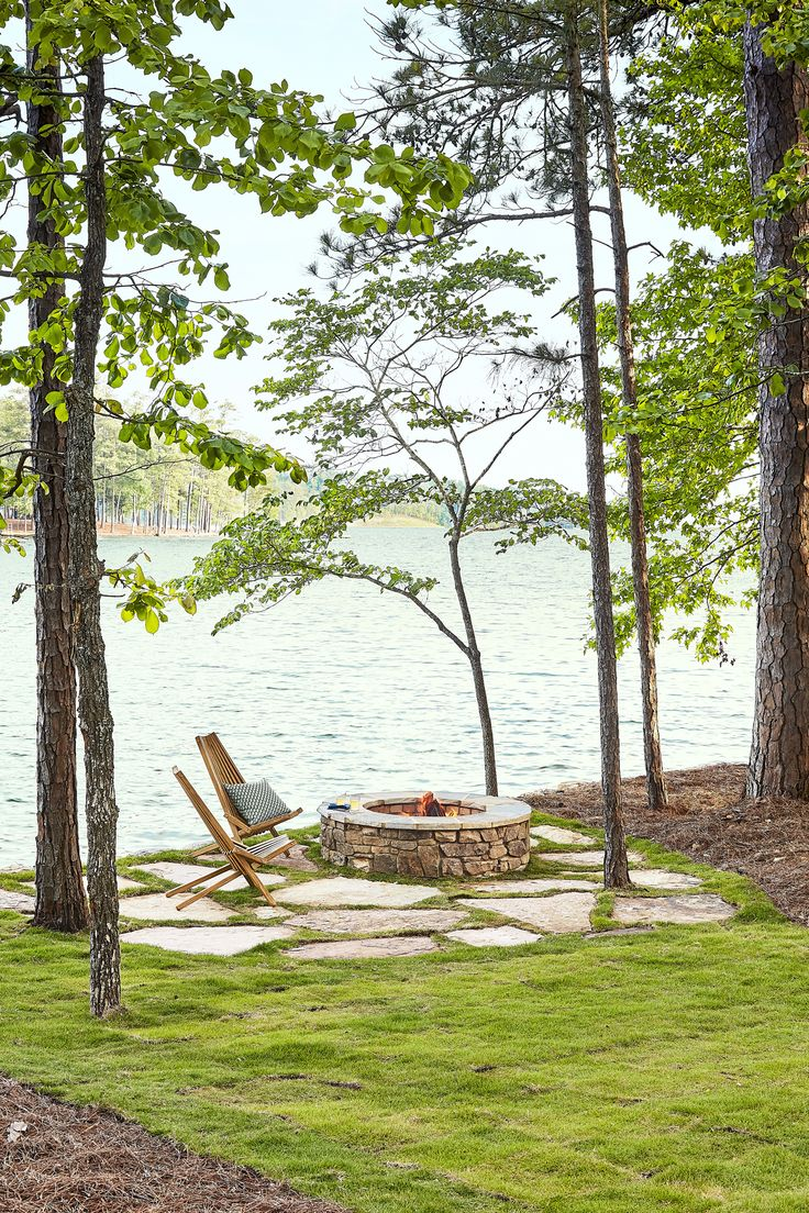Backyard Patio by the Lake - A pair of iconic clean-lined Kentucky stick chairs adds a layer of sophistication to the natural stone fire pit—echoing the rustic.