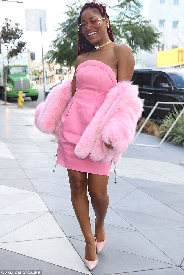 Strike a pose: Keke Palmer stepped out in a bubblegum pink strapless dress with a matching fur coat and heels while out in Los Angeles on Wednesday