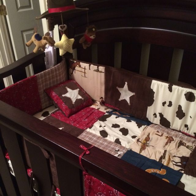 Yeehaw! Perfect for your little cowboy or cowgirl.  Love the stars and cow print bedding set and mobile for this western-themed nursery. #nurseryideas #westernnursery #nursery