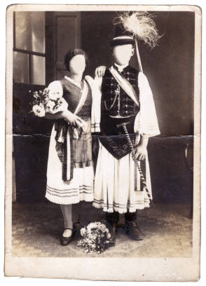 This anonymous couple from Hungary are pictured in their wedding attire in the year 1930. Traditional Hungarian folk costumes are not as common as they once were, but they are still sometimes worn for weddings and festivals. Hungarian folk dress is colorful and richly embroidered. It may feature lace, sashes, boots, or embroidered shoes. Puffed sleeves characterize a woman's garment, while a vest and long sleeves is worn as a part of male attire.