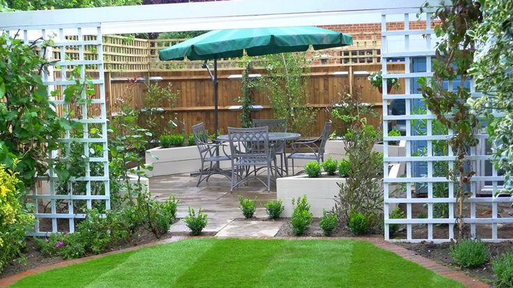 trellis between garden beds | Balau decking, raised rendered beds, privacy screen,s brick edged lawn ...