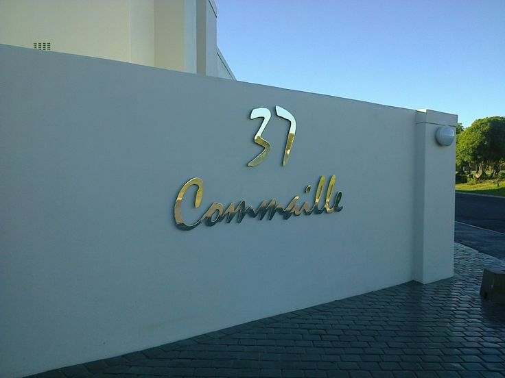 Stainless Steel Sign, Grade 316 with Mirror Polished finish and mounted with Mounting Studs.
