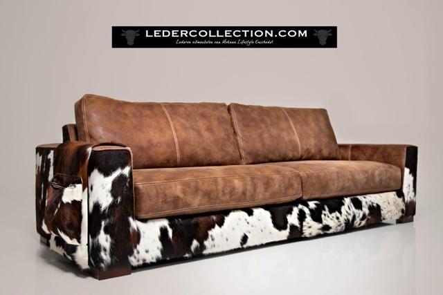 Mooie bank! Royale diepe bank Nebraska in combinatie met koeien huid en africa leder Tabac. Op site nog meer mooie items