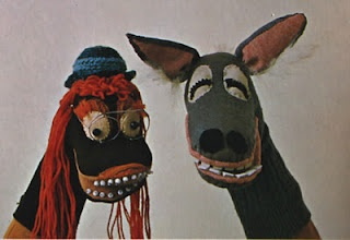 Retro seventies sock animals/puppets. Great idea for recycling your old socks!