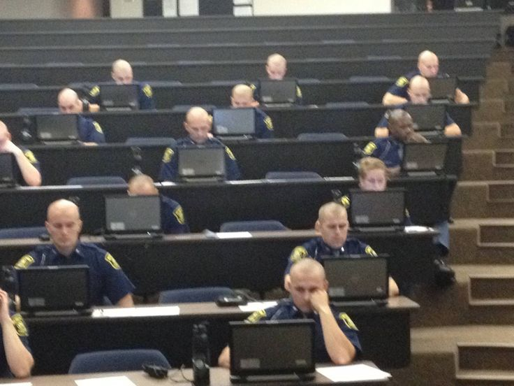 Michigan State Police recruits taking the MColes licensing