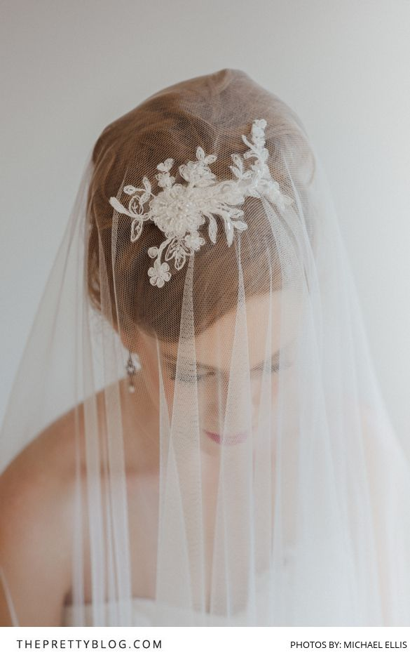 A beautiful head piece with a lace veil adds some vintage flair to your bridal attire! | Photographer: Michael Ellis | Model: Kim Rose | Accessories: Bella Chiara