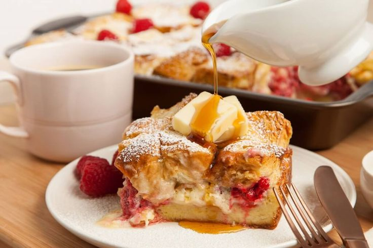 Stuffed french toast casserole is made the night before by layering challah bread, raspberries and mascarpone. Pour the custard over everything and let it sit tight till morning. This is the best stuffed french toast you will ever have!
