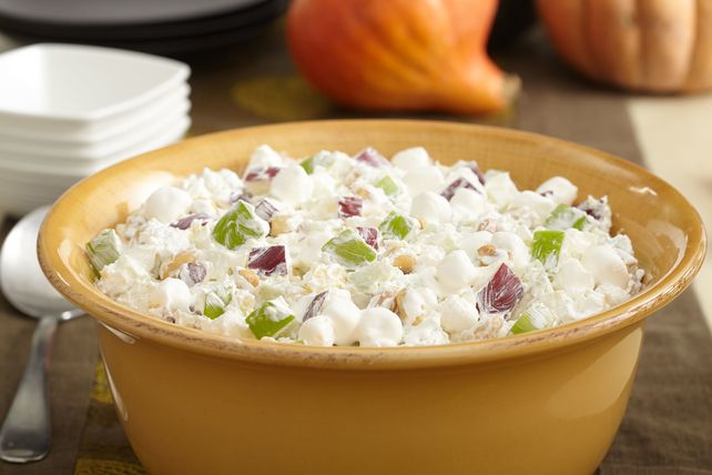 This Easy Taffy Apple Salad is a sweet and sticky delight—made with chopped apples, pineapples in syrup, whipped topping and mini marshmallows.
