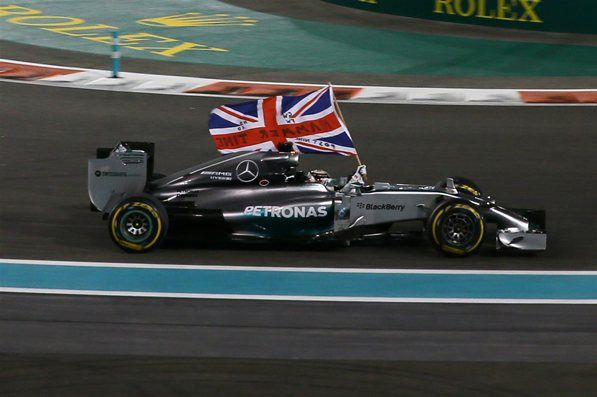 Race winner and World Champion Lewis Hamilton (GBR) Mercedes AMG F1 W05 celebrates. Formula One World Championship, Rd19, Abu Dhabi Grand Prix, Race, Yas Marina Circuit, Abu Dhabi, UAE, Sunday, 23 November 2014
