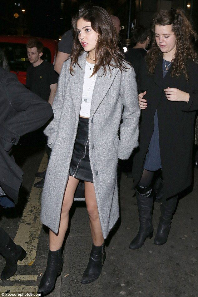 Leggy:Danielle, 20, looked gorgeous in a zip-up leather mini skirt teamed with ankle boots for her London night out., keeping warm in a chic grey coat