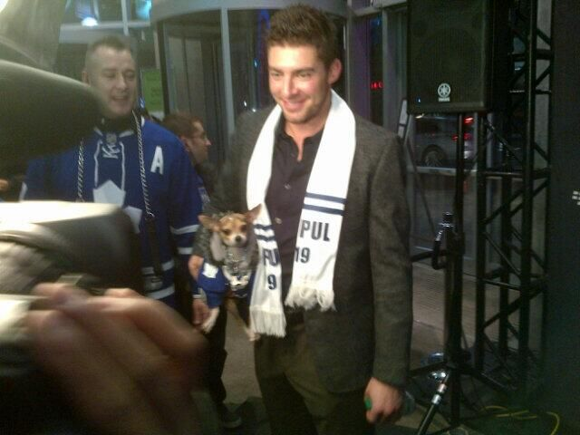 Toronto Maple Leafs: Joffrey Lupul holds a dog in a Lupul jersey on the red carpet at the 2014 MLSE Players Gala on March 6, 2014.
