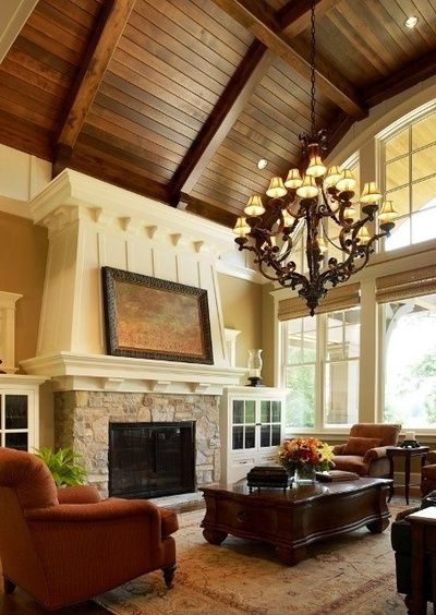 RUSTIC LIVING ROOM: Stone fireplace, wood ceiling. While this is a bit different than your space, it may be another way to think about introducing that warm wood element to your space? I like the white wood contrasted with the stained wood ceiling.