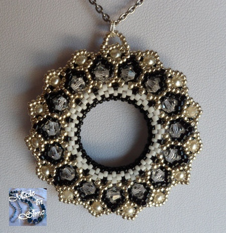 Bhaktapur double face pendant by MadeinSimo on Etsy, €45.00
