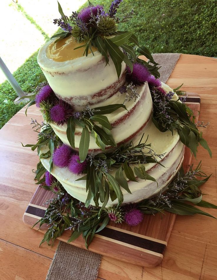 This beautiful semi-naked Lemon Curd Poppy Seed wedding cake with thistles, lavender, wild olive leaves, rosemary, and caspia was created by Cowboy David's Bake Shoppe in Viroqua, WI. This WBA member received the great honor of CRITIC'S CHOICE for Best of the Best 2017 of the Coulee Region (a LaCrosse Tribune recognition) AND was just recognized as The Viroqua New Business of the Year! #WBAMember #SupportYourLocalBakery #KeepYourDoughLocal — with David Rogan-Nordstrom and CowboyJoe…