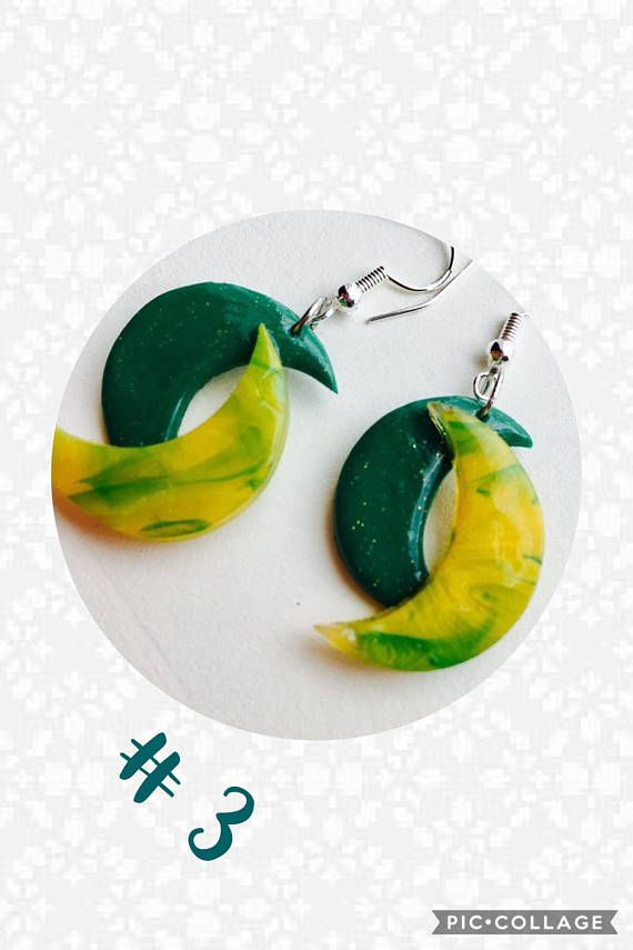 A unique pair of moon shaped earrings handmade using polymer clay..