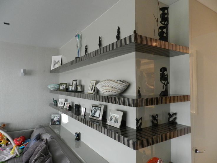 MDF painted wood cladding with floating shelves made from exotic veneer