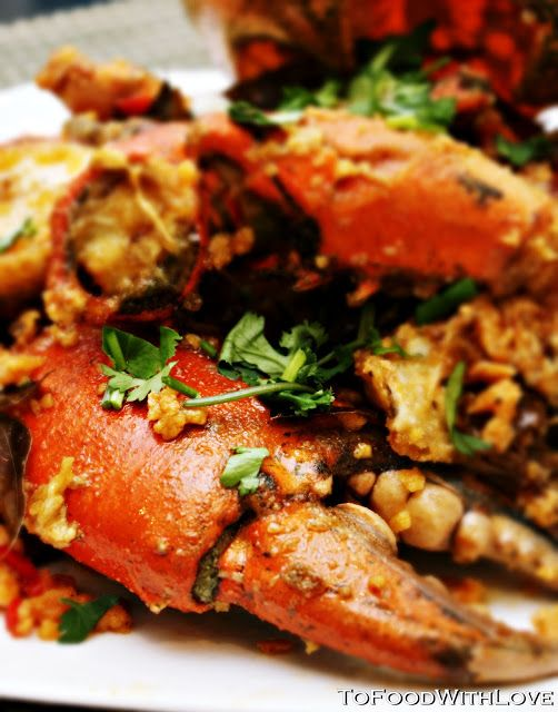 CRABS WITH SALTED EGG YOLK ==INGREDIENTS== 1kg fresh crabs, 1 cup tapioca flour, Oil for deep-frying, 3 salted egg yolks (I used salted duck eggs), 5 bird's eye chillies, 2 stalks curry leaves, 3 T butter, ½ t salt or to taste, ½ t pepper, 1½-2 t sugar, 3 T evaporated milk====