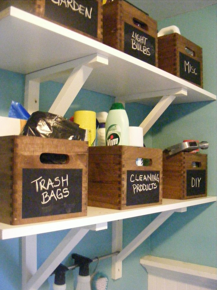 Stylish storage using wooden crates. Get small, unfinished crates from the craft store, wood stain & poly coat, black board paint- the instructions should be self-explanatory. ;)