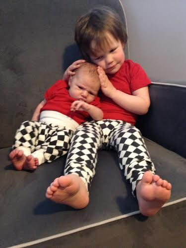 Big brother and little sister looking super sweet in their black diamond Teegy Tights!