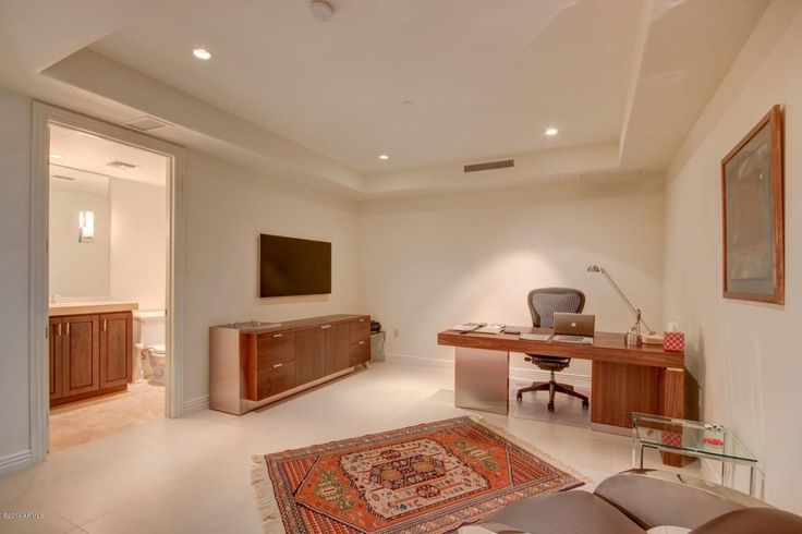 Contemporary Home Office with limestone tile floors, Carpet, High ceiling