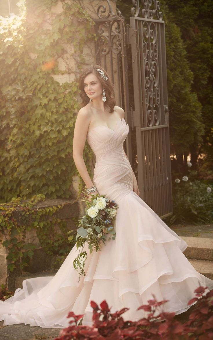 Essense of Australia's eye-catching Regency organza pleated wedding dress features a sweetheart neckline, a slimming dropped waist, & beautiful layers on its skirt.