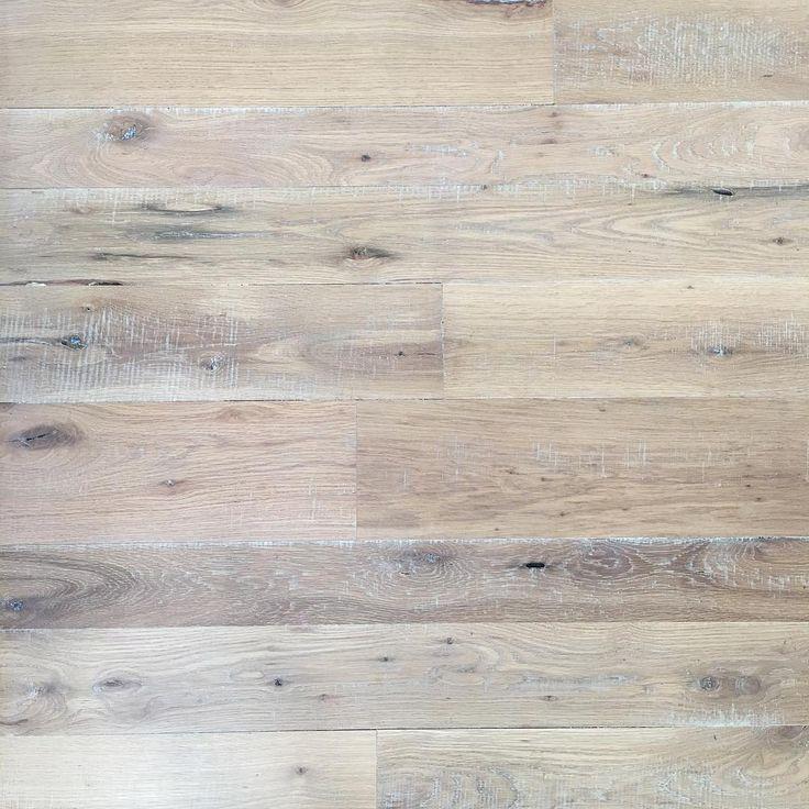 White Oak rough sawn hardwood floors done at random widths and finished with a 5% smoke stain. #coastalfarmhouse #hardwoodflooring